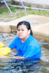Portrait of Angry Little Asian Girl swimming in swimming pool