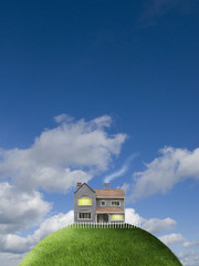 House on top of grassy globe