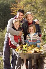 Portrait of family near wheelbarrow