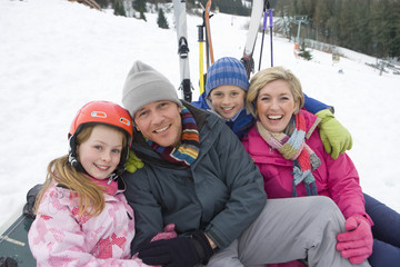 Portrait of young family on ski slope