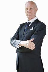 Senior businessman, arms crossed, cut out