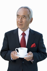 Mature businessman with teacup, cut out