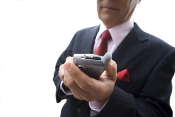 Businessman using mobile phone, mid section, cut out