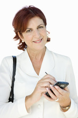 Businesswoman with electronic organiser, portrait, close-up, cut out