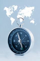Compass on the world map background.