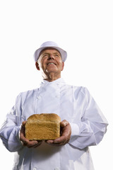 Portrait of baker in white uniform holding loaf of bread, cut out
