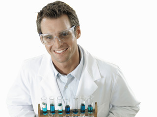 Scientist holding rack of test tubes, smiling, portrait, elevated view, cut out