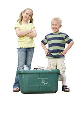 Brother and sister with recycling bin, smiling, portrait, cut out