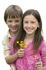 Boy giving girl flowers, smiling, portrait, cut out
