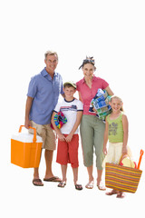Family of four with cooler, towels and bag, smiling, portrait, cut out