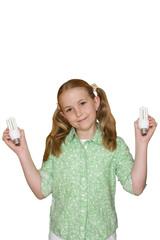 Girl holding energy saving light bulbs, cut out