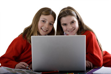 Sisters using laptop to do homework, cut out