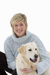 Portrait of mid adult woman with dog, cut out