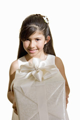 Girl dressed in bridesmaid dress, holding wedding gift, smiling, front view, portrait, cut out