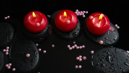 Beautiful spa still life of candles, zen stones with drops and p