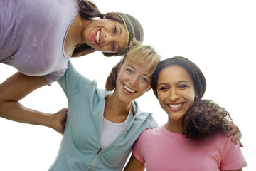 Three teenage girls smiling, portrait, low angle view, cut out