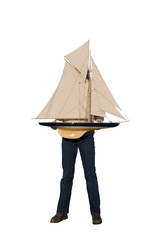 Woman obscuring face with model boat, cut out