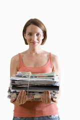 young woman holding pile of magazines, cut out