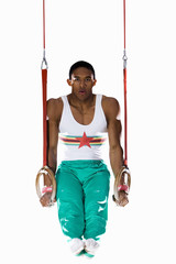 athletic man on swing ropes, cut out
