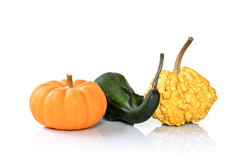 Three decorative pumpkins isolated on white background