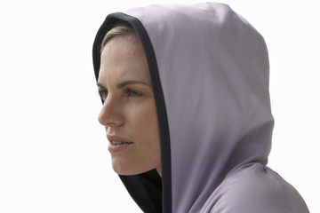 close-up of young woman wearing a hood, cut out