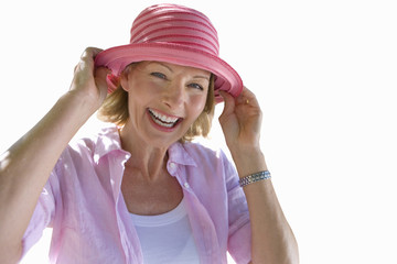 senior woman smiling, wearing sun hat, cut out