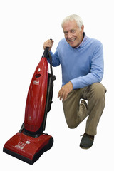 senior man holding vacuum cleaner, on one knee, cut out
