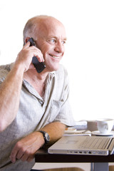 senior man on telephone with cup of coffee, cut out