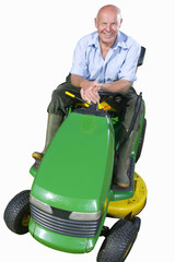 senior man sitting on lawn mower, cut out