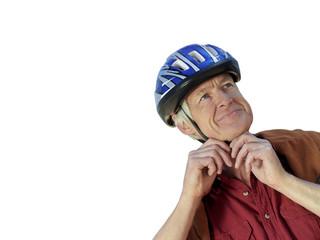 senior man fastening bicycle helmet, cut out