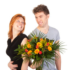 Man and woman standing backwards with flowers