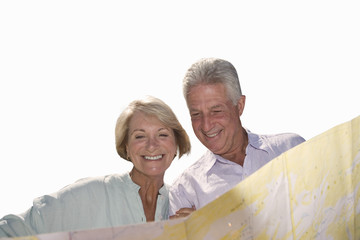 senior couple looking at map together, cut out