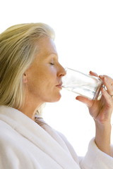 senior woman drinking glass of water, cut out