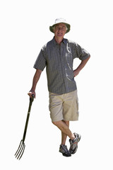 senior man leaning on garden fork, cut out