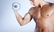 Fitness man lifting weights on gray background