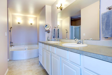Refreshing light lavender bathroom with white cabinet