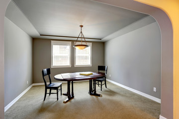 Grey room with table and chairs