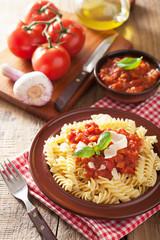 italian classic pasta fusilli with tomato sauce and basil