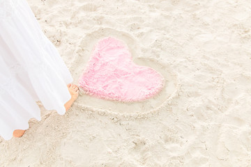 Drawing  heart on the sand