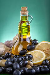 Healthy olive oil with black and green olives, lemon and garlic
