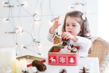 little girl playing with Christmas decoration