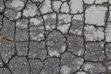 Cracks in eroded asphalt