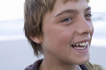 Close up of young boy smiling