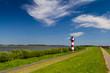 Leinwanddruck Bild - Leuchtturm an der Elbe