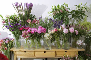 Variety of flowers in vases on display in flower shop