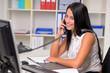 canvas print picture - Freundliche junge Frau am Telefon