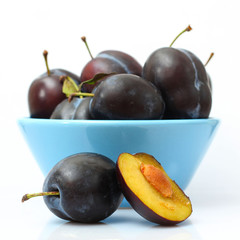 fresh plums in blue bowl