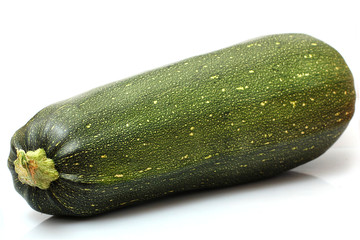 one fresh zucchini on a white background