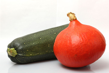 marrows and zucchini on a white background
