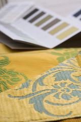 Colour swatches and wallpaper design samples, close-up (still life, differential focus)